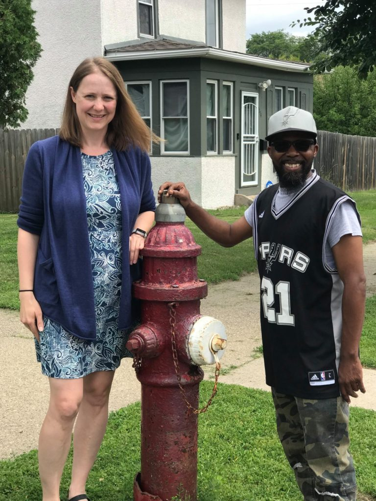 WCNO outreach coordinators posing near a fire hydrant