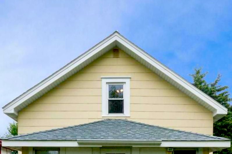 A picture of the top of a small house, representing residential services.